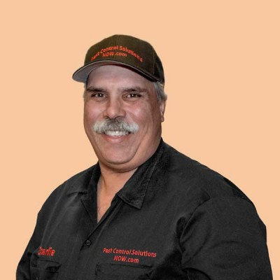 Photo of Charlie Roy - Owner of Pest Control Solutions NOW.com in company shirt and hat